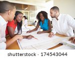 group of architects discussing... | Shutterstock . vector #174543044