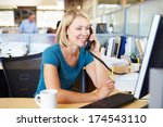 woman on phone in busy modern... | Shutterstock . vector #174543110