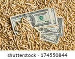 top view of pellets with american dollars - stock photo