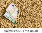 top view of pellets with euro bills - stock photo