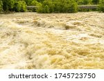 Small photo of Raleigh, North Carolina/United States-May 31, 2020: The Photo Depicts Massive Discharge of Water into the Neuse River from Falls Lake after Heavy Rains. The Torrent of Water Creates Whitecaps and Whir