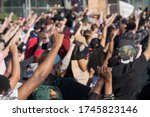 Small photo of Minneapolis, Minnesota/United States of America - May 30, 2020: Protestors raise their hands in solidarity outside of the Fifth Police Precinct in Minneapolis in response to the death of George Floyd.