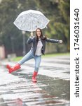 Young Woman Dances In The Rain...