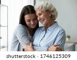 Small photo of Young granddaughter snuggle to elderly grandmother, different generations women enjoy communication missed each other appreciate and value time together, mommy and grown up daughter connection concept