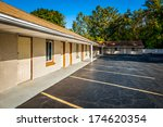 empty parking lot near motel | Shutterstock . vector #174620354