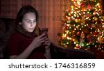 A Young Woman Sits With A...