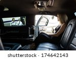 elegant woman in limousine with ... | Shutterstock . vector #174642143