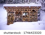 Firewood Stack With Snow At...