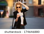 young business woman using a... | Shutterstock . vector #174646880