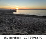 The Sandy Shore Of The Bay In...