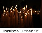 Many Religious Candles Of...