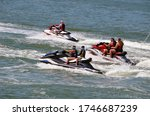 Group Of Jet Skiers On The...