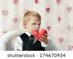 little boy with red heart in... | Shutterstock . vector #174670934
