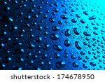 water drops on blue background | Shutterstock . vector #174678950