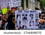 Small photo of Miami Downtown, FL, USA - MAY 31, 2020: George Floyd, Tamir Rice, Atatiana Jefferson, Trayvon Martin, Ahmed Aubrey, Eric Garner, Sandra Bland, Freddie Gray, Alton Sterling poster. US people protest