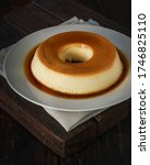 Small photo of Milk Pudding or Pudim de leite. Homemade milk and caramel custard pudding