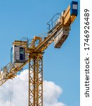 Small photo of Close up details of a construction crane.Turret Slewing Crane against blue sky