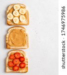 Small photo of Set of peanut butter open sandwiches or toasts (toasted bread, peanut butter, banana and fresh strawberry slices). Healthy morning breakfast. Top view food. Copy space. White concrete background.