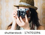 Hipster Woman Taking Photos...