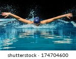 young woman in blue cap and... | Shutterstock . vector #174704600