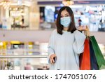 Young Woman Shopping With Bag...