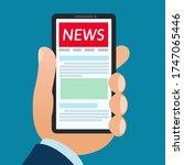 man read a news on smartphone ...   Shutterstock .eps vector #1747065446