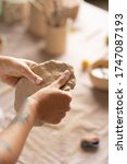 The Potter\'s Woman Hands Are...