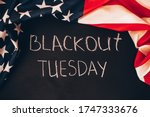 Small photo of Blackout tuesday inscription on a black background with american flag around. Black lives matter, blackout tuesday2020 concept.