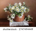A Bouquet Of Spring Flowers In...