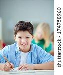 portrait of happy schoolboy at... | Shutterstock . vector #174758960