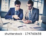 image of two young businessmen... | Shutterstock . vector #174760658