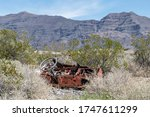 Small photo of Aimless Steering Wheel Abandoned and Shot With Bullet Holes in in the Mojave Desert, Tule Springs Fossil Beds National Monument, Las Vegas, Nevada, USA