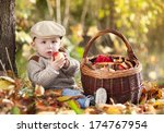 happy child in warm clothes is... | Shutterstock . vector #174767954