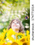happy child with sunflowers... | Shutterstock . vector #174771014