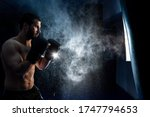 Thai Boxing Fighter On A Dark...