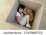 A Little Girl Hide In Cardboard ...