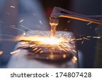 worker cutting steel pipe using ... | Shutterstock . vector #174807428