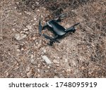drone stands on ground ready to fly. in forest. Close up view. - stock photo