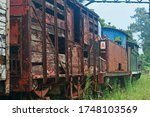 Decaying Wooden Cart Behind An...