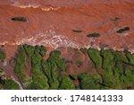 Sandstone Cliffs Washing Into...