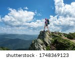 Girl Hiker With A Backpack...