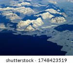 View of the northern Antarctic Peninsula from high altitude during daytime
