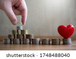 Small photo of putting money coin saving for concept philanthropy ,donation and finance insurance