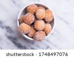 Donut Holes With Sugar On Bowl...