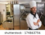 happy chef looking at camera... | Shutterstock . vector #174863756