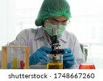 doctor looking in microscope in ... | Shutterstock . vector #1748667260