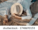 Woman With A Sun Hat Lying Dow...
