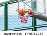 Basketball Ring With A Net And...