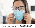 Woman wearing surgical mask due ...