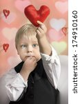 little boy with red heart in... | Shutterstock . vector #174910160